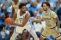 CHAPEL HILL, NC - JANUARY 4: Jeremiah Francis #13 of the University of North Carolina is defended by Jose Alvarado #10 of Georgia Tech during a game between Georgia Tech and North Carolina at Dean E. Smith Center on January 4, 2020 in Chapel Hill, North Carolina.