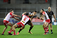 20th November 2020; Totally Wicked Stadium, Saint Helens, Merseyside, England; BetFred Super League Playoff Rugby, Saint Helens Saints v Catalan Dragons; Jonny Lomax of St Helens tackles Israel Folau of Catalan Dragons