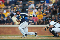 Ivan Gonzalez (32) of the West Virginia Mountaineers follows through on his swing against the Wake Forest Demon Deacons in Game Four of the Winston-Salem Regional in the 2017 College World Series at David F. Couch Ballpark on June 3, 2017 in Winston-Salem, North Carolina. The Demon Deacons walked-off the Mountaineers 4-3. (Brian Westerholt/Four Seam Images)
