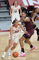 Arkansas guard Chelsea Dungee (33) drives Thursday, Feb. 11, 2021, around Mississippi State center Yemiyah Morris (right) during the first half of play in Bud Walton Arena. Visit nwaonline.com/210212Daily/ for today's photo gallery. <br /> (NWA Democrat-Gazette/Andy Shupe)