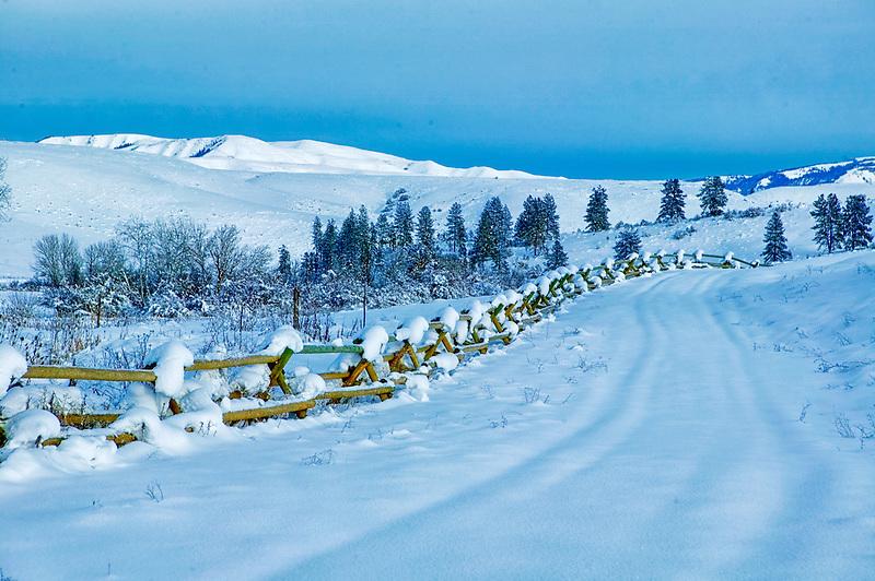 Fence with snow on farmland. Near Halfway, Oregon