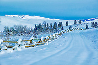 Fence with snow on farmland. Near Halfway, Oregon