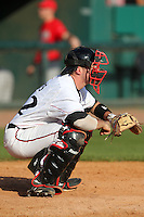Catcher Nick Rohlfs #42 of the Cincinnati Bearcats during the Big East-Big Ten Challenge vs. the Ohio State Buckeyes at Al Lang Field in St. Petersburg, Florida;  February 18, 2011.  Cincinnati defeated Ohio State 11-5.  Photo By Mike Janes/Four Seam Images