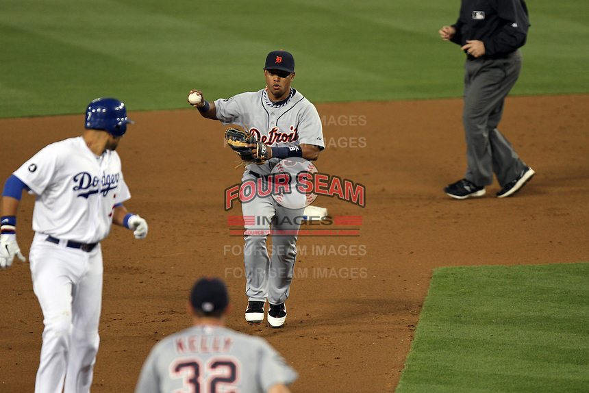 Detroit Tigers shortstop Ramon Santiago #39 catches Los Angeles Dodgers outfielder Matt Kemp #27 off base before tagging him out at Dodger Stadium on June 21, 2011 in Los Angeles,California. (Larry Goren/Four Seam Images)