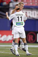 The Revolution's Taylor Twellman celebrates scoring a goal with teammate Pat Noonan who assisted on the goal and had scored the team's first goal. The New England Revolution were defeated by the MetroStars 3 to 2 on Saturday September 11, 2004 at Giant's Stadium, East Rutherford, NJ..