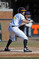 Tennessee Volunteers right fielder Scott Price #5 squares  to bunt during a game against the UNLV Runnin' Rebels at Lindsey Nelson Stadium on February 22, 2014 in Knoxville, Tennessee. The Volunteers defeated the Rebels 5-4. (Tony Farlow/Four Seam Images)