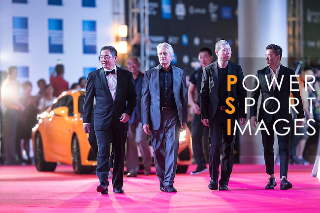 Michael Douglas, Feng Xiaogang (black T-shirt), and Wang Zhonglei (no tie) walk the Red Carpet event at the World Celebrity Pro-Am 2016 Mission Hills China Golf Tournament on 20 October 2016, in Haikou, China. Photo by Victor Fraile / Power Sport Images