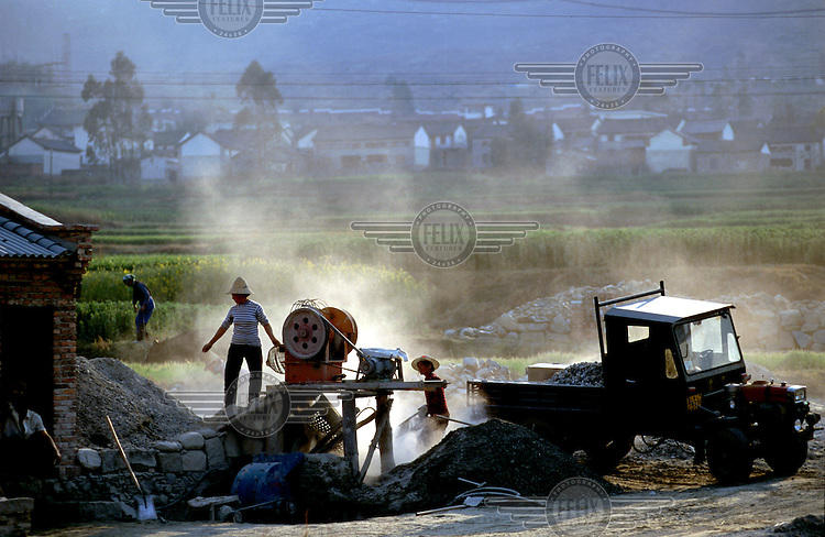 Women working. House building for affluent peasants...