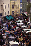 Saturday tourists visiting and Londoners Portobello Road Notting Hill west London 1990s 90s UK