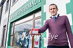 Donald Grogan from Grogan's Pharmacy, Dingle, with a Kit Kat prescription.
