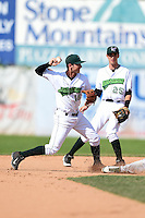 Jamestown Jammers shortstop Tyler Filliben (15) attempts to turn a double play as Erik Forgione (25) backs up the play  during a game against the Vermont Lake Monsters on July 13, 2014 at Russell Diethrick Park in Jamestown, New York.  Jamestown defeated Vermont 6-2.  (Mike Janes/Four Seam Images)