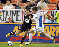 Carlos Verela #11 of D.C. United pulls the ball in from Bobby Convey #11 of the San Jose Earthquakes during an MLS match at RFK Stadium in Washington D.C. on October 9 2010. San Jose won 2-0.