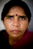 "47 year old Sampat Pal Devi, founder and leader of the 10,000 strong 'Gulabi Gang' (Pink Gang). Pal Devi, an impoverished mother of five, has emerged to become something of a messianic figure in the region. She left her job as a government helth worker because she didn't find it satisfying enough. ""I wanted to work for the people, not for myself alone."" In the badlands of Bundelkhand, one of the poorest parts of one of India's most populous states, a gang of female vigilantes have sprung up to fight the oppression of a caste-ridden, feudalistic and male dominated society. In a land where dowry demands and domestic and sexual violence are common, the 'Gulabi Gang', so called for their uniform of shocking pink saris, are picking up their lathis to fight against corruption and violence against women."