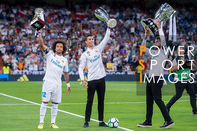 Marcelo Vieira Da Silva (l), Cristiano Ronaldo (c) and Sergio Ramos of Real Madrid hold up their trophies prior to the La Liga 2017-18 match between Real Madrid and Valencia CF at the Estadio Santiago Bernabeu on 27 August 2017 in Madrid, Spain. Photo by Diego Gonzalez / Power Sport Images