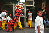 Chinese kids out on Chinese New Year. Binondo, Manila, Philippines. 31 January 2003