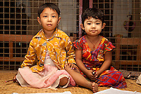 Myanmar, Burma. Bagan.  Burmese Children, Two Girls.  They are wearing thanaka paste on their faces, a cosmetic sunscreen.