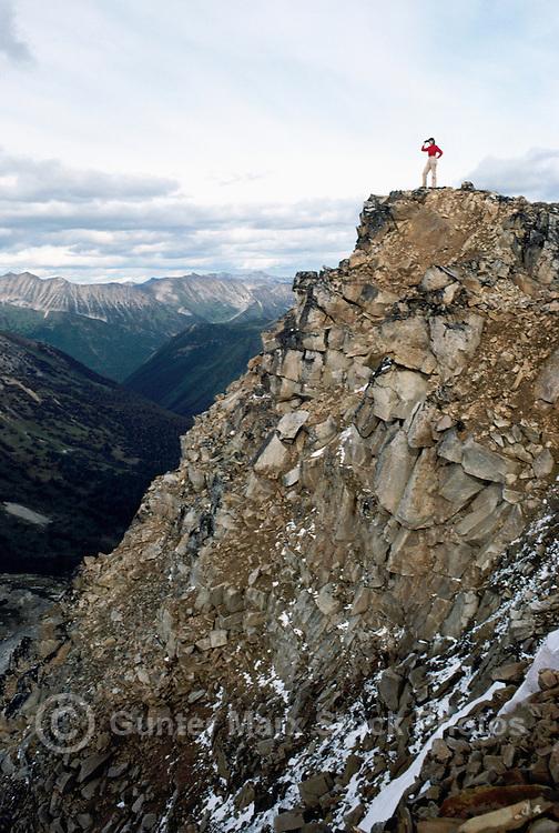 Coast Mountains near Duffey Lake, along Duffey Lake Road (Highway #99), Southwestern BC, British Columbia, Canada - Hiker on Cliff Edge at Blowdown Pass, Trailhead to Stein Valley Nlaka'pamux Provincial Park (Model Released)