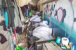 © Joel Goodman - 07973 332324 . 30/04/2017 . Salford, UK . Two men lie sleeping on sofas on the towpath . Homeless men are living in a towpath tunnel in Saford , in the shadow of the Ordsall Chord railway link and a large , Chinese-backed housing development. Photo credit : Joel Goodman
