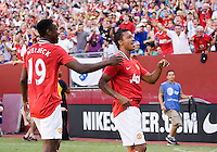 Nani (17) of Manchester United celebrates his goal with teammate Danny Welbeck (19) during the friendly at FedEX Field in Landover, MD.  Manchester United defeated FC Barcelona, 2-1.