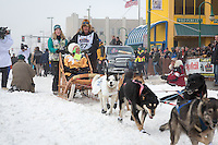 Sonny Lindner and team leave the ceremonial start line at 4th Avenue and D street in downtown Anchorage during the 2013 Iditarod race. Photo by Jim R. Kohl/IditarodPhotos.com