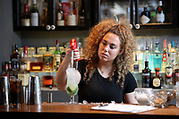 FAO SHAAKIRA, METRO<br />Pictured: A young woman prepares a cocktail at the bar. Saturday 20 May 2017<br />Re: Jack Daniels Promotion, 29 Park Place in Cardiff, Wales, UK.