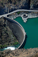 aerial photograph of Monticello Dam, Lake Berryessa, Napa County, California; the Morning Glory Spillway is completely expososed during drought conditions.