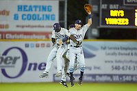 (L-R) Princeton Rays outfielders Tony Pena (7), Grant Witherspoon (5), and Jordan Qsar (8) celebrate their win over the Pulaski Yankees at Calfee Park on July 14, 2018 in Pulaski, Virginia. The Rays defeated the Yankees 13-1.  (Brian Westerholt/Four Seam Images)
