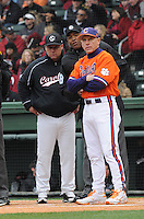 Head coach Chad Holbrook of the South Carolina Gamecocks, left, meets head coach Jack Leggett of the Clemson Tigers  at home plate on Saturday, March 2, 2013, at Fluor Field at the West End in Greenville, South Carolina. Clemson won the Reedy River Rivalry game 6-3. (Tom Priddy/Four Seam Images)