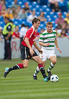 July 16, 2010 Jonny Evans No. 23 of Manchester United and James Forrest No. 49 of Celtic FC  during an international friendly between Manchester United and Celtic FC at the Rogers Centre in Toronto.