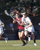 Boston College midfielder Kara Magley (11) brings the ball forward as Harvard University defender Amelia Capone (5) pressures.