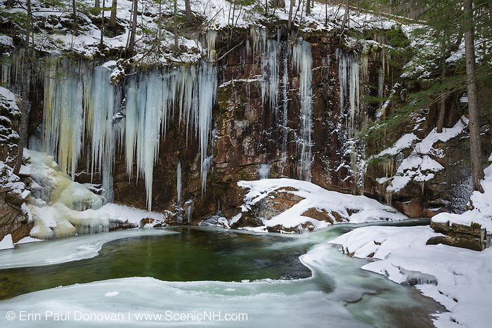The Lower Pool at Sabbaday Falls in Waterville Valley, New Hampshire USA during the winter months. These falls are located on Sabbaday Brook off of the Kancamagus Highway in the White Mountains.
