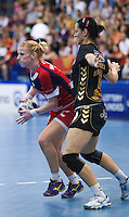 30 MAY 2012 - LONDON, GBR - Lynn McCafferty (GBR) of Great Britain (left) looks for a way through the Montenegro defence during the women's 2012 European Handball Championship qualification match at the National Sports Centre in Crystal Palace, Great Britain (PHOTO (C) 2012 NIGEL FARROW)