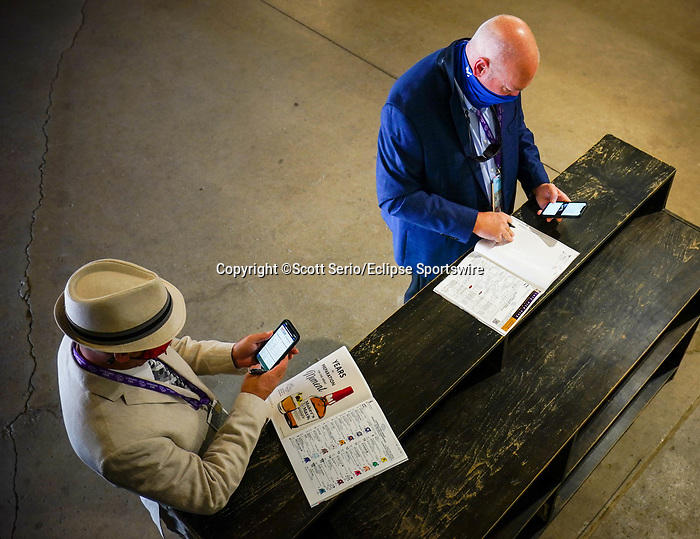 November 6, 2020: Attendees place bets before Future Stars Friday racing begins at Keeneland Racetrack in Lexington, Kentucky, on Friday, November 6, 2020. Scott Serio/Eclipse Sportswire/Breeders Cup/CSM
