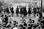 Playing up for the cameras Lewisham, London.1977<br /> Police protect members of the National Front, during the so-called Battle of Lewisham, which took place on 13 August. 500 members of the National Front marched from New Cross to Lewisham, various counter-demonstrations by approximately 4,000 people led to violent clashes between the two groups and between the anti-NF demonstrators and police. 5,000 police officers were present and 56 officers were injured in the riots, 11 of whom were hospitalised. 214 people were arrested for obstructing the police, threatening behaviour, assault, possession of an offensive weapon and throwing missiles. Later disturbances in Lewisham town centre saw the first use of police riot shields on the UK mainland.