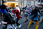 "Trump supporters and anti-Trump demonstrators clash near Black Lives Matter Plaza during the ""Million MAGA March"" on November 14, 2020 in Washington, D.C.  Thousands of supporters of U.S. President Donald Trump gathered to protest the results of the 2020 presidential election won by President-Elect Joe Biden.  Photograph by Michael Nagle"