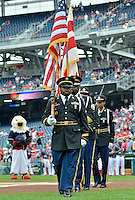 5 September 2011: The Washington DC Police Color Guard leave the field after the performance of the National Anthem, prior to a game against the Los Angeles Dodgers at Nationals Park in Los Angeles, District of Columbia. The Nationals defeated the Dodgers 7-2 in the first game of their 4-game series. Mandatory Credit: Ed Wolfstein Photo