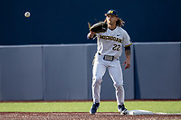 Michigan Wolverines first baseman Jordan Brewer (22) waits for a throw at first against the Western Michigan Broncos on March 18, 2019 in the NCAA baseball game at Ray Fisher Stadium in Ann Arbor, Michigan. Michigan defeated Western Michigan 12-5. (Andrew Woolley/Four Seam Images)