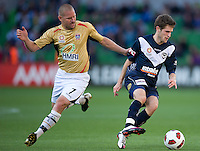 MELBOURNE, AUSTRALIA - DECEMBER 27: Mate Dugandzic of the Victory and Kasey Wehrman of the Jets compete for the ball during the round 20 A-League match between the Melbourne Victory and the Newcastle Jets at AAMI Park on December 27, 2010 in Melbourne, Australia. (Photo by Sydney Low / Asterisk Images)