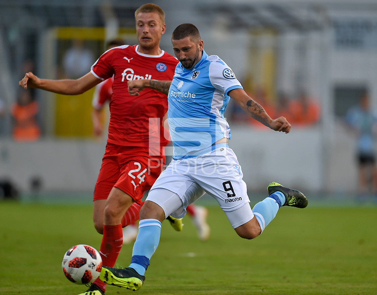 19.08.2018, Football DFB Pokal 2018/2019, 1. round, Tsv 1860 Muenchen - Holstein Kiel, Gruenwalderstadium Muenchen.  Hauke Wahl (Kiel)  -  Sascha Moelders (TSV 1860 Muenchen) <br /><br /><br />***DFB rules prohibit use in MMS Services via handheld devices until two hours after a match and any usage on internet or online media simulating video foodaye during the match.*** *** Local Caption *** © pixathlon<br /> <br /> Contact: +49-40-22 63 02 60 , info@pixathlon.de