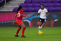 ORLANDO CITY, FL - FEBRUARY 18: Crystal Dunn #19 looks to take on a defender during a game between Canada and USWNT at Exploria stadium on February 18, 2021 in Orlando City, Florida.