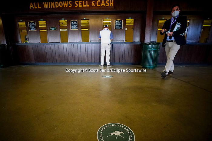 November 6, 2020: An attendee places a bet on a race at Keeneland Racetrack in Lexington, Kentucky, on Friday, November 6, 2020. Scott Serio/Eclipse Sportswire/Breeders Cup/CSM