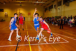 Conor Flynn Cougars shields drives past Stefan Manojovic Blue Demons during their National league game in Killarney on Saturday night
