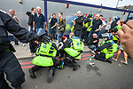 © Joel Goodman - 07973 332324 . 03/09/2011 . London , UK . Police medics treat injured people as the English Defence League hold a rally in Aldgate, near Tower Hamlets in East London. The group had intended to march however the Home Secretary banned all marches in the area. Photo credit : Joel Goodman