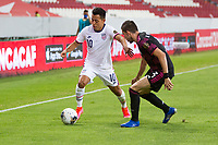 , MEXICO - : Sebastian Saucedo #10 of the United States attempts to move past Manuel Mayorga #3 of Mexico during a game between  and undefined at  on ,  in , Mexico.