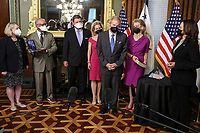 U.S. Vice President Kamala Harris, right, listens as Bill Nelson, former Democratic Senator from Florida and administrator of the National Aeronautics and Space Administration (NASA), second from right, speaks, following a swearing in ceremony. Alongside Nelson, from left, current nominee for Deputy NASA Administrator Pam Melroy, former NASA Administrator under Obama-Biden Charlie Bolden, his son Bill Nelson Jr., his daughter Nan Ellen Nelson, former NASA Administrator Jim Bridenstine, virtual from a laptop, and his wife, Grace Nelson, holding the bible, in the Eisenhower Executive Office Building in Washington, D.C., U.S., on May 3, 2021. The Senate confirmed Nelson on April 29 and had served as the chairman and ranking member of the Senate subcommittee that oversees NASA. <br /> Credit: Oliver Contreras / Pool via CNP /MediaPunch