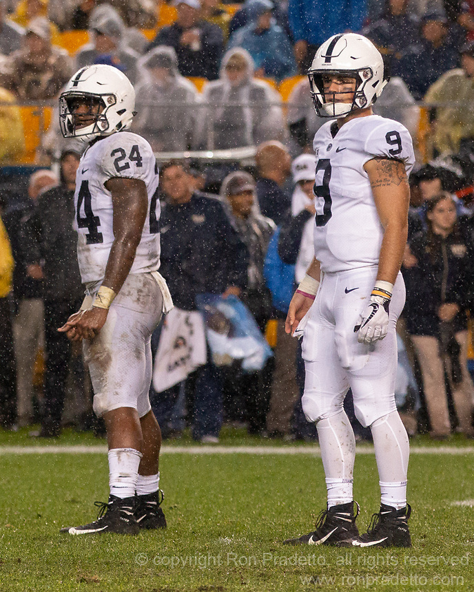 Penn State running back Miles Sanders (24) and quarterback Trace McSorley (9) look for signals from the sideline. The Penn State Nittany Lions defeated the Pitt Panthers 51-6 on September 08, 2018 at Heinz Field in Pittsburgh, Pennsylvania.