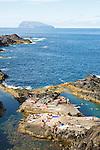 Natural swimming pool near Santa Cruz das Flores. Corvo island on the background.