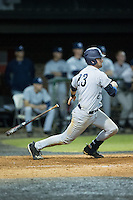 Zach Almond (23) of the Catawba Indians follows through on his swing against the Belmont Abbey Crusaders at Abbey Yard on February 7, 2017 in Belmont, North Carolina.  The Crusaders defeated the Indians 12-9.  (Brian Westerholt/Four Seam Images)