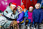 Niamh, Sean, Hannah and Aoife Walsh ready to get their face painted by Georgina Downes at Snow Day in the square in Tralee on Saturday.