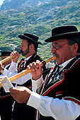Nr St Bernard, Switzerland. Men playing on alpen horns.